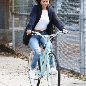 Selena riding a bike in Los Angeles