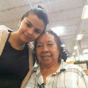 Selena with a fan in Texas