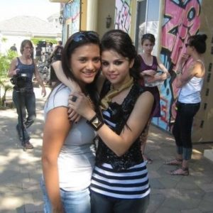 Selena with a fan on set of Tell Me Something I Dont Know music video in 2008