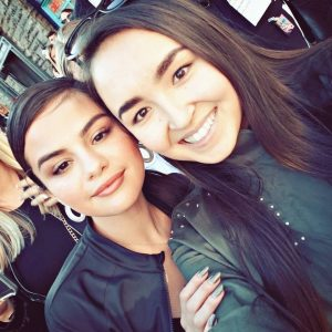 New pic of Selena with a fan at Puma DEFY City