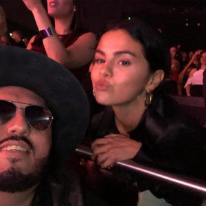 19 October new pic of Selena with a fan at Jennifer Lopez's concert this September