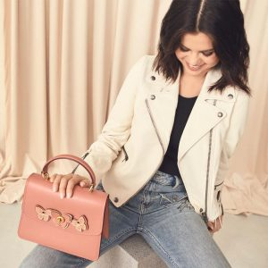 24 May Selena on Instagram: All @Coach combo -biker jacket and butterfly parker bag