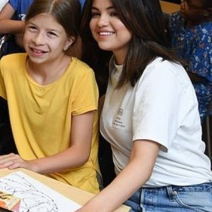 7 June Selena with children at CMH in Kansas