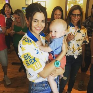 8 June Selena with a fan's child at The Big Slick in Kansas