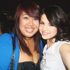 12 October new pics of Selena with a fan backstage in 2010
