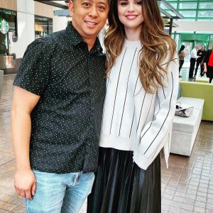 23 October Selena with a fan in Los Angeles