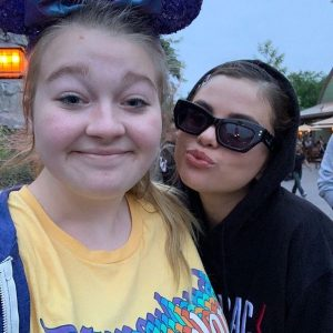 16 May new pic of Selena with a fan last year in Disneyland