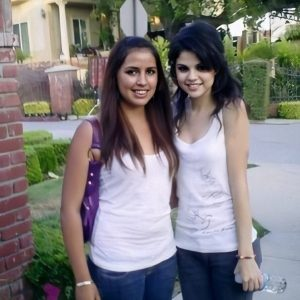 5 August new pic of Selena with a fan on set of Tell Me Something I Dont Know music video