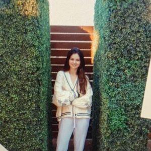 28 August Selena wearing Taylor Swift's cardigan