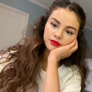 25 March @RareBeauty on Instagram: We stan @selenagomez's signature look with a bold red lip